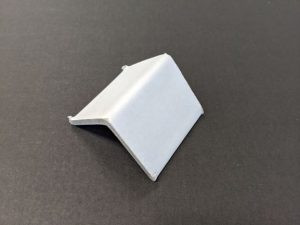 white cardboard strapping corner
